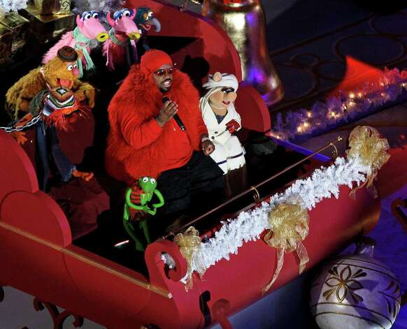 Singer CeeLo Green performs in a sleigh with the Muppets before the Rockefeller Center Christmas Tree lighting during the 80th annual tree lighting ceremony at Rockefeller Center in New York, Wednesday, Nov. 28, 2012. (AP Photo/Kathy Willens) Photo: Kathy Willens, Associated Press / Associated Press
