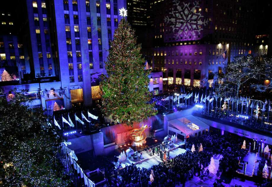 The Rockefeller Center Christmas Tree is lit during the 80th annual tree lighting ceremony at Rockefeller Center in New York, Wednesday, Nov. 28, 2012.  (AP Photo/Kathy Willens) Photo: Kathy Willens, Associated Press / Associated Press