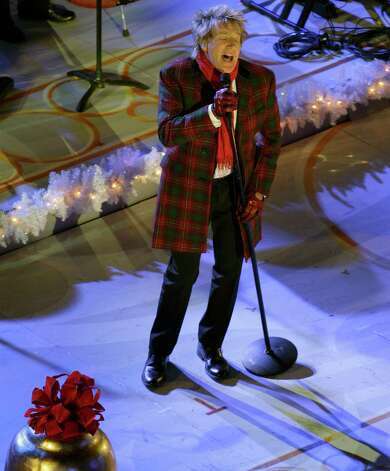 Singer-songwriter Rod Stewart performs before the Rockefeller Center Christmas Tree is lit during the 80th annual tree lighting ceremony at Rockefeller Center in New York, Wednesday, Nov. 28, 2012.  (AP Photo/Kathy Willens) Photo: Kathy Willens, Associated Press / Associated Press