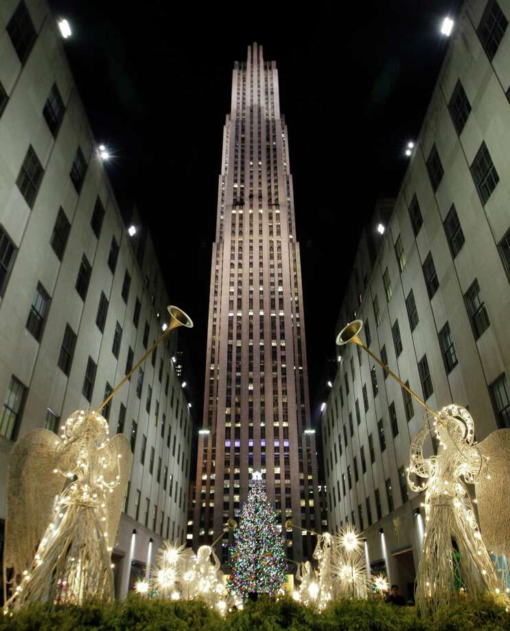 Angels in lights frame the Rockefeller Center Christmas tree as seen from the Channel Gardens after the tree was lit during the 80th annual tree lighting ceremony at Rockefeller Center in New York, Wednesday, Nov. 28, 2012.  (AP Photo/Kathy Willens) Photo: Kathy Willens, Associated Press / Associated Press