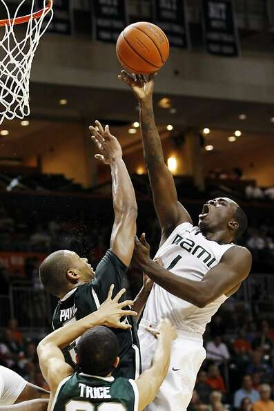 Durand Scott drives in Miami's victory over Michigan State.