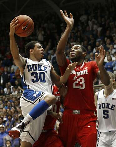 Duke's Seth Curry tries to maneuver around Ohio State's Amir Williams. Curry had only four points. Photo: Gerry Broome, Associated Press
