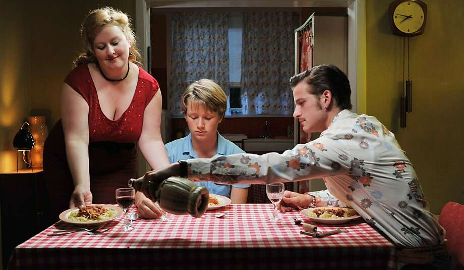"Yvette (Eva Van Der Gucht) serves son Pim (Jelle Florizoone) and boyfriend Zoltan (Thomas Coumans) in ""North Sea Texas."" Photo: Strand Releasing"