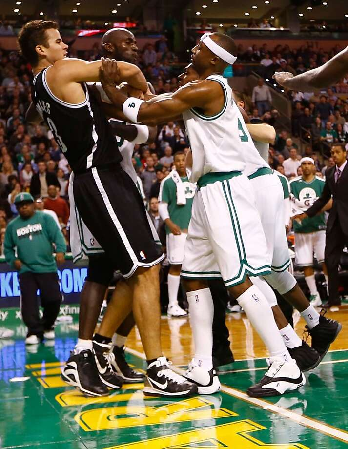 Celtics Jason Terry (right), Rajon Rondo (behind Terry) and Kevin Garnett take issue with a foul by Kris Humphries (left). Photo: Jared Wickerham, Getty Images
