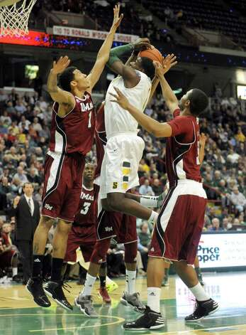 Siena's O.D. Anosike powers to the basket during their game against the University of Massachusetts at the Times Union Center in Albany, NY Wednesday Nov. 28, 2012. (Michael P. Farrell/Times Union) Photo: Michael P. Farrell