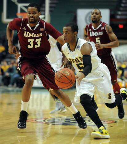 Siena's Evan Hymes brings the ball down court during their game against the University of Massachusetts at the Times Union Center in Albany, NY Wednesday Nov. 28, 2012. (Michael P. Farrell/Times Union) Photo: Michael P. Farrell