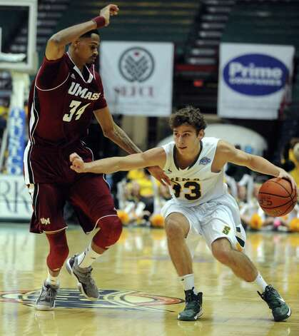 Siena's Rob Poole brings the ball down court during their game against the University of Massachusetts at the Times Union Center in Albany, NY Wednesday Nov. 28, 2012. (Michael P. Farrell/Times Union) Photo: Michael P. Farrell
