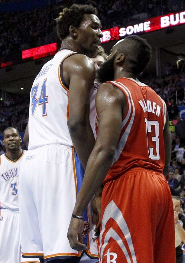 Thunder center Hasheem Thabeet (34) and Rockets guard James Harden argue in the second quarter. (AP Photo/Sue Ogrocki) (Associated Press)