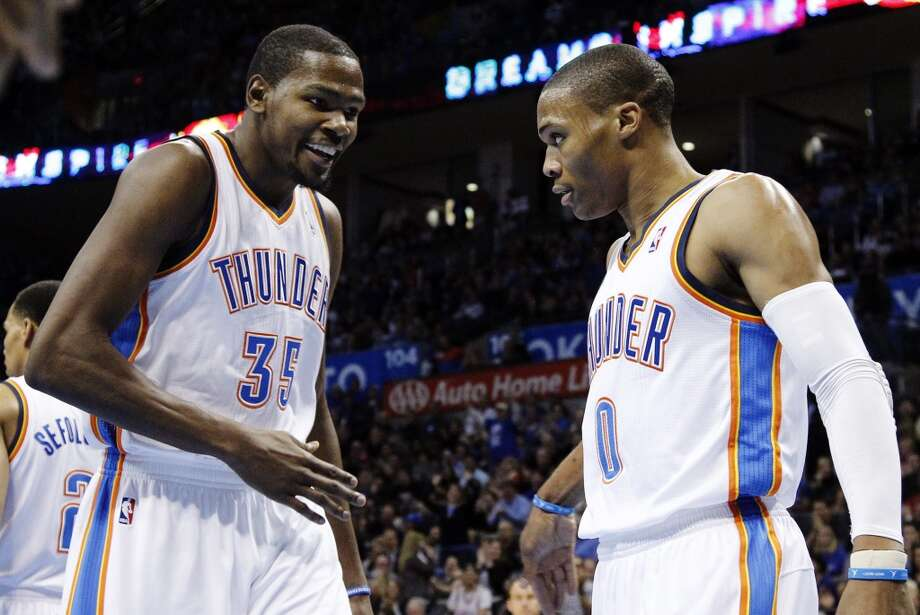 Kevin Durant and guard Russell Westbrook react after Westbrook blocked one of James Harden's shots. (AP Photo/Sue Ogrocki) (Associated Press)