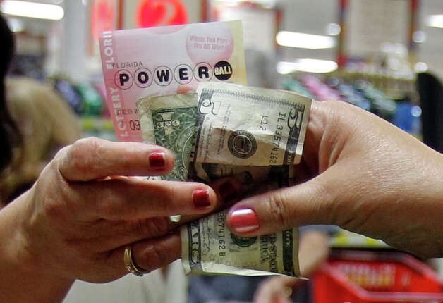 A customer buys three Powerball tickets at a local supermarket in Hialeah, Fla.,Tuesday, Nov. 27, 2012. There has been no Powerball winner since Oct. 6, and the jackpot already has reached a record level for the game. Already over $500 million, it is the second-highest jackpot in lottery history, behind only the $656 million Mega Millions prize in March.  (AP Photo/Alan Diaz) Photo: Alan Diaz