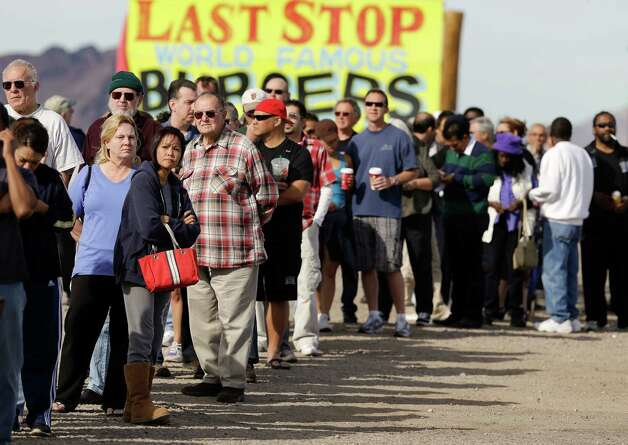A crowd, consisting of residents from California and Nevada, lines up outside the Arizona Last Stop convenience store and souvenir shop to buy Powerball tickets, Tuesday, Nov. 27, 2012, in White Hills, Ariz. There has been no Powerball winner since Oct. 6, and the jackpot already has reached a record level for the game of over $500 million. (AP Photo/Julie Jacobson) Photo: Julie Jacobson
