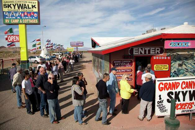 A crowd of people line up outside the Arizona Last Stop convenience store and souvenir shop to buy Powerball tickets, Tuesday, Nov. 27, 2012, in White Hills, Ariz. There has been no Powerball winner since Oct. 6, and the jackpot already has reached a record level for the game. Already over $500 million, it is the second-highest jackpot in lottery history, behind only the $656 million Mega Millions prize in March. (AP Photo/Julie Jacobson) Photo: Julie Jacobson