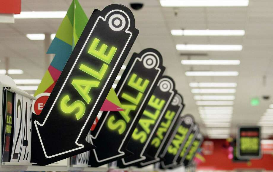 FILE -In this Friday, Nov. 23, 2012, file photo, sale signs are displayed at a Target store in Colma, Calif. Big retailers, from Best Buy to Target to Toys R Us, are engaging in a price war this holiday season, and shoppers can score some good deals if they know how to navigate them. But what's different this holiday season is that Best Buy and Target are matching online retailers such as Amazon.com for the first time. That's a big deal, since online prices tend to be lower than those in the store. (AP Photo/Jeff Chiu) Photo: Jeff Chiu