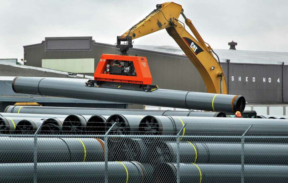 Workers stack segments of steel pipe for the Millennium Pipe Line Project at the Port of Albany Monday afternoon March 31, 2008.  The project will to carry natural gas into the NYC Metro area.  (John Carl D'Annibale / Times Union archive) Photo: John Carl D'Annibale / Albany Times Union