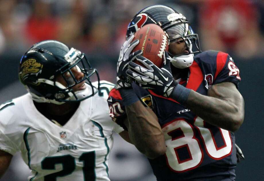 Veteran wide receiver Andre Johnson's two-game receiving extravaganza began with a 14-catch, 273-yard explosion against Derek Cox, left, and the Jaguars on Nov. 18. Photo: Brett Coomer, Staff / © 2012  Houston Chronicle