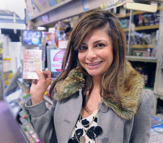 Hina Pervez-Nigro of White Plains, N.Y.,  holds up the Powerball lottery tickets she purchased from the Greenwich Cigar Store on Railroad Avenue, Wednesday afternoon, Nov. 28, 2012. The jackpot for the lottery exceeded $550 million. Photo: Bob Luckey / Greenwich Time