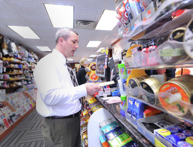 Paul Thomas of Boston buys $215 worth of Powerball lottery tickets at Zyn's News & Cigar Store on Greenwich Avenue, Wednesday afternoon, Nov. 28, 2012. The jackpot for the lottery exceeded $550 million. Photo: Bob Luckey / Greenwich Time