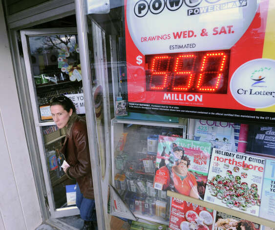 Marla Striar of Rye Brook, N.Y., exits Zyn's News & Cigar store on Greenwich Avenue, Wednesday afternoon, Nov. 28, 2012, after buying Powerball lottery tickets for herself and a family member. The jackpot for the lottery exceeded $550 million. Photo: Bob Luckey / Greenwich Time