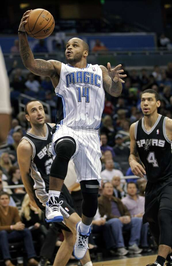 Orlando Magic's Jameer Nelson (14) goes in for a shot in front of San Antonio Spurs' Manu Ginobili, left, of Argentina, and Danny Green (4) during the first half of an NBA basketball game on Wednesday, Nov.  28, 2012, in Orlando, Fla. (AP Photo/John Raoux) (Associated Press)