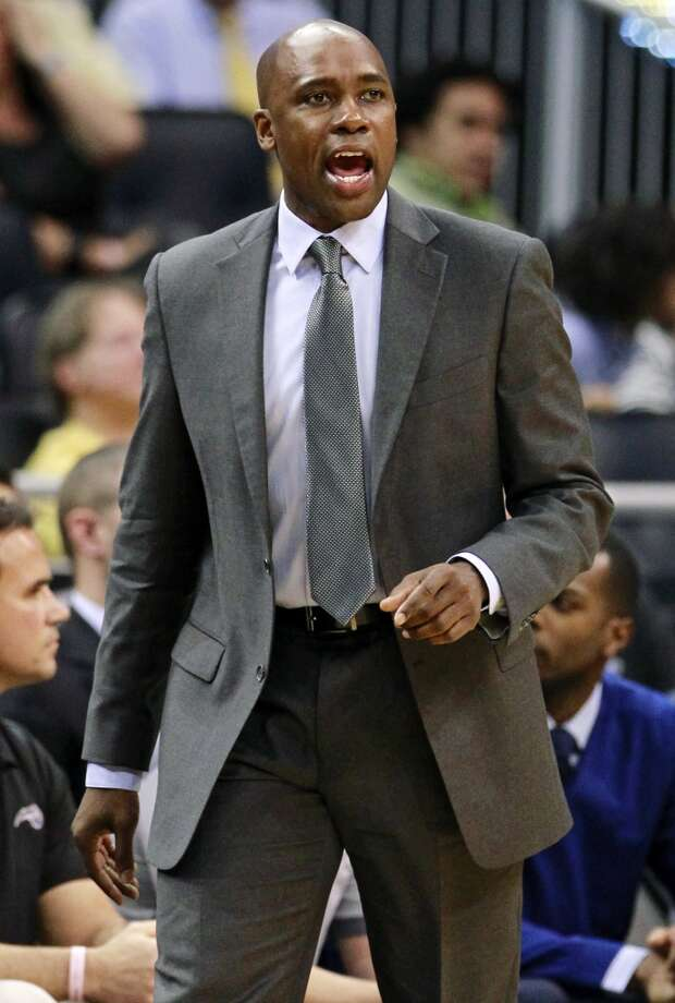 Orlando Magic head coach Jacque Vaughn shouts instructions to his players during the second half of an NBA basketball game against the San Antonio Spurs, Wednesday, Nov. 28, 2012, in Orlando, Fla. The Spurs won 110-89. (AP Photo/John Raoux) (Associated Press)