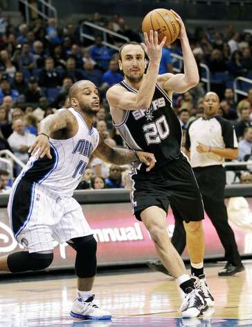 San Antonio Spurs' Manu Ginobili (20), of Argentina, drives past Orlando Magic's Jameer Nelson (14) during the second half of an NBA basketball game, Wednesday, Nov. 28, 2012, in Orlando, Fla. The Spurs won 110-89. (AP Photo/John Raoux) (Associated Press)