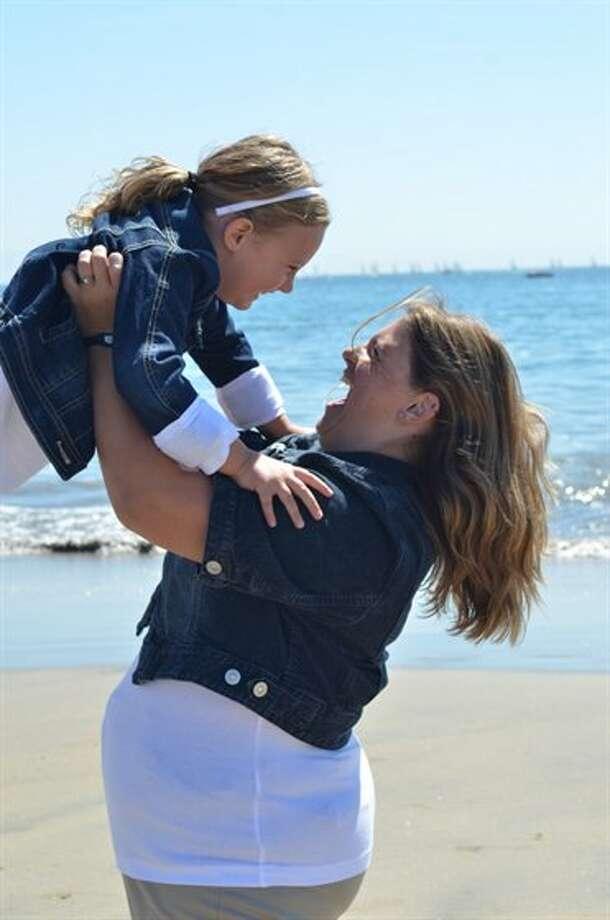 Now: Bella (5 years) and Mom on the beach in Santa Cruz Summer 2012, 5 years later. (Stinagoerke)