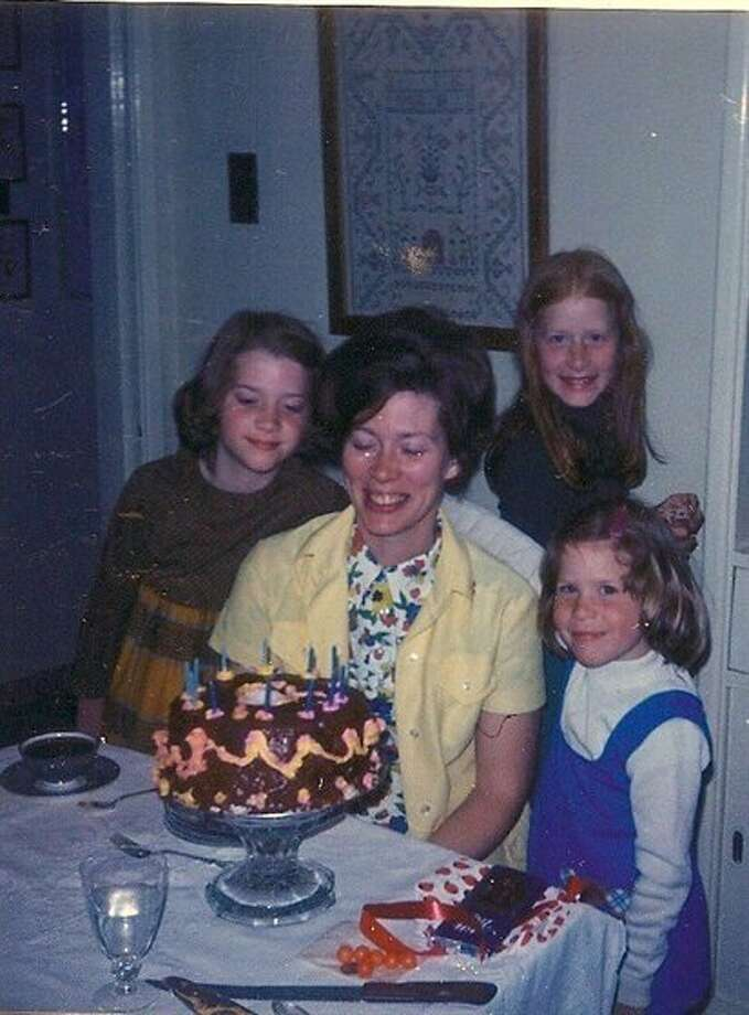 Then: Mom's birthday, 1974. My sisters and I baked a cake for Mom's 35th birthday. The cake looks pretty much as you would expect from the decorating talents of a 6, 8, and 10-year old. (msmargie)