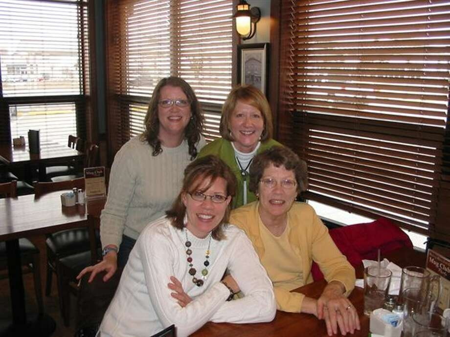 Now: Mom's birthday, 2007. Mom and Nancy have switched sides in this updated version, and we can now afford to take Mom out for her birthday instead of trying to tackle it on our own, but we still love to be together. (msmargie)