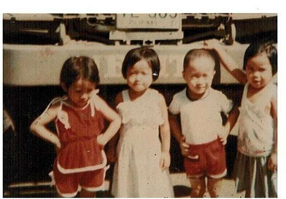 Then: Here is a picture of my future wife (2nd from left) and 3 of her cousins, all 4 were born in 1977. There are in their home country The Philippines. (justanotherdude)