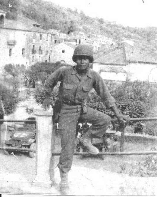 Al Dietrick was 22 years old and a Tech Sgt. in the 36th Infantry Division of the Texas National Guard when, as part of the Allied invasion of Italy, he was photographed by a buddy in the village of Altavilla Silentina. Dietrick had to keep the undeveloped film in his duffle bag for several weeks before he could get it developed, which explains the poor quality of the nearly 70-year-old photo.  (Al Dietrick / MySanAntonio.com)