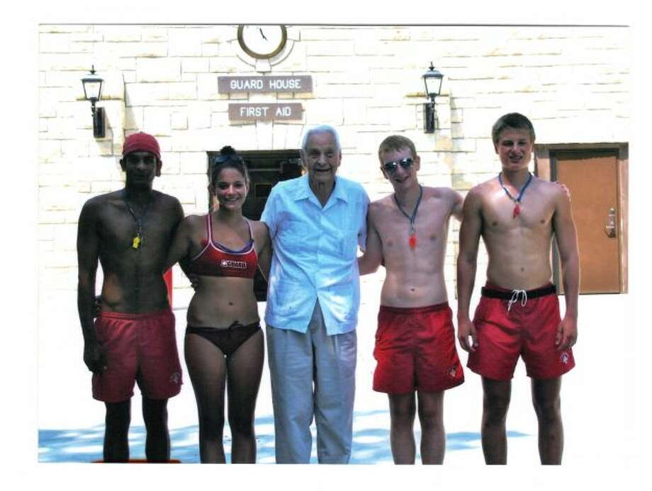 Dr. Buck Rikli, 94 years old, poses with today life guards at Naperville, Illinois swimming pool. (Barbara Clark / MySanAntonio.com)