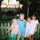 In this photo taken in 2004, cousins Madison Saulter (from left), Logan Saulter, Samantha Schulte and Kierstan Saulter get together at the home of their great aunt/grandmother Bonnie Keller in Castroville to remember their great-grandmother Fanny Keller, who died that year.  (Bonnie Keller / MySanAntonio.com)
