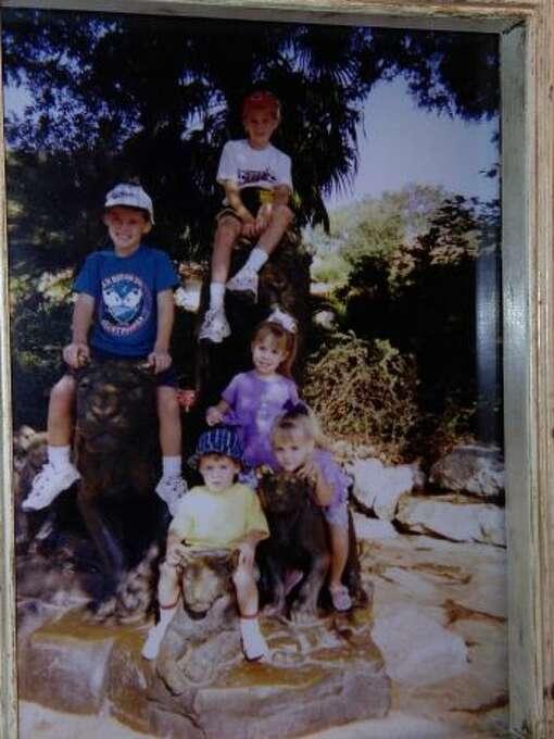 The Lyle Grandkids at the San Antonio Zoo in 2000. From top down: Matt, Scott, Denise, Christy, & Todd. (Carol Wilson / MySanAntonio.com)
