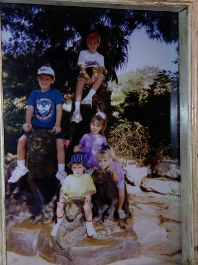 The Lyle Grandkids at the San Antonio Zoo in 2000. From top down: Matt, Scott, Denise, Christy, & Todd. (Carol Wilson / MySanAntonio.com)