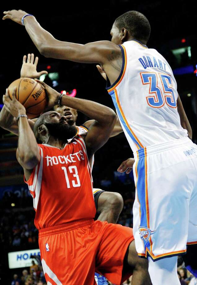 Guard James Harden (13) found himself bottled up for much of the night against forward Kevin Durant (35) and the Thunder, who forced their former teammate into his worst night as a Rocket. Photo: Sue Ogrocki, STF / AP