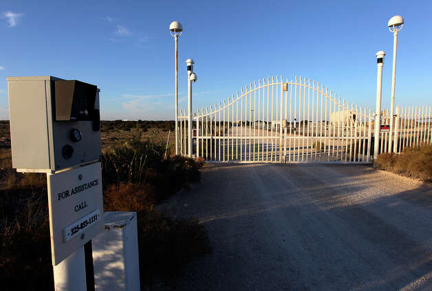 View of the front gate of the Yearning for Zion ranch in Eldorado, Texas on Wednesday, Nov. 28, 2012. The Texas attorney general's office filed documents to seize the ranch on Wednesday. The property belonged to Warren Jeffs who served as the spiritual leader and prophet of the Fundamentalist Church of Latter Day Saints. Jeffs was convicted on two child sex charges and sentenced to life plus 20 years in prison. Photo: Kin Man Hui, San Antonio Express-News / © 2012 San Antonio Express-News