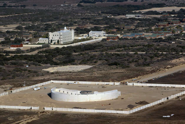 Aerial view of an unfinished amphitheater and a church at the Yearning for Zion ranch in Eldorado, Texas on Wednesday, Nov. 28, 2012. The Texas attorney general's office filed documents to seize the ranch on Wednesday. The property belonged to Warren Jeffs who served as the spiritual leader and prophet of the Fundamentalist Church of Latter Day Saints. Jeffs was convicted on two child sex charges and sentenced to life plus 20 years in prison. Photo: Kin Man Hui, San Antonio Express-News / © 2012 San Antonio Express-News