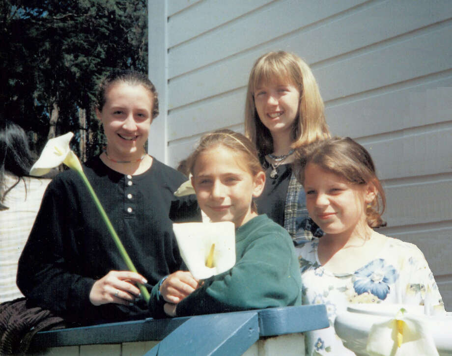 Then: Christina Drake, Malia Nims, Lizzy Eisenberg, Maggie Eisenberg on annual spring break stay at Stinson Beach. Photos taken on the steps of the St. Mary Magdalene Catholic Church, Bolinas