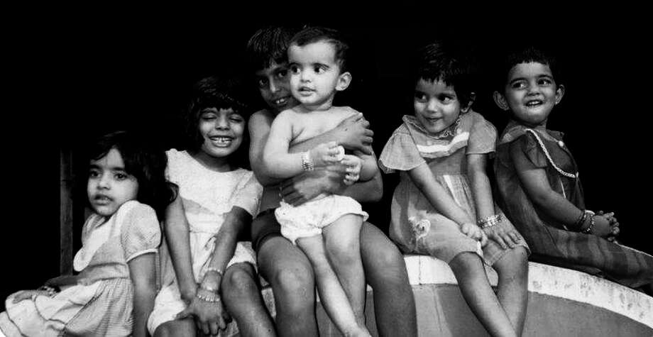 Then: Tiny Tots. Kerala, India, 1992: Five happy selves, at our grandparents place, giving the expression we were best at!