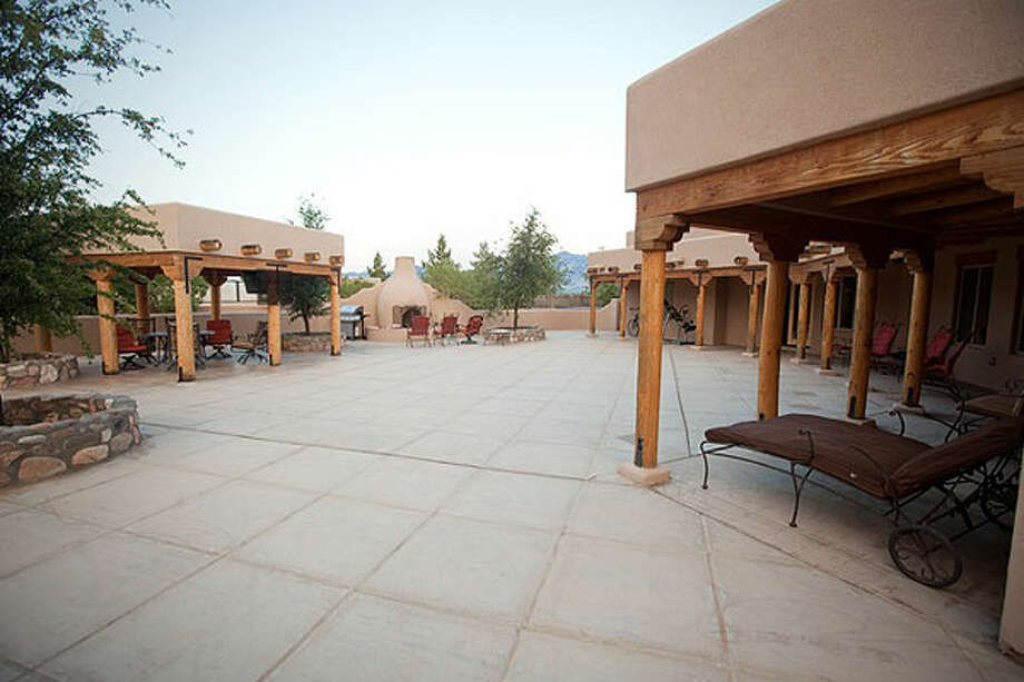 Grand patio and furnishings, all sold at auction for pennies on the dollar. Photos: CNBC and Auction Company of America.