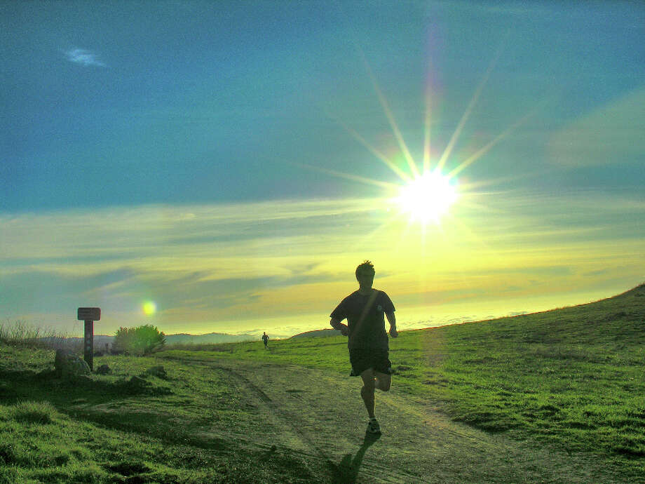Trail runner, late afternoon, at Russian Ridge (Deane Little)