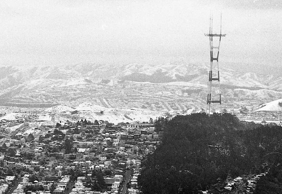 Sutro Tower in an aerial photo taken by the Chronicle's Arthur Frisch -- later in the day when some of the snow had melted. Pretty sure that's San Bruno Mountain State Park covered with snow in the distance. Photo: Arthur Frisch, The Chronicle / ONLINE_YES