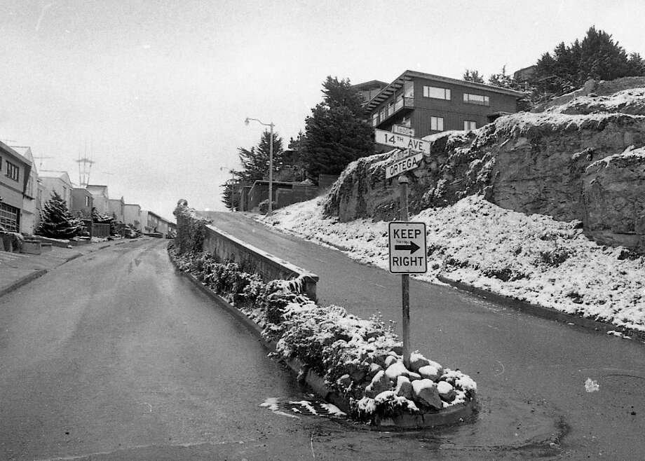 Golden Gate Heights was one of the areas heavily dusted -- this was taken early in the morning near 14th and Ortega. Note Sutro Tower in the distance. The tower was less than three years old. Photo: Clem Albers, The Chronicle / ONLINE_YES