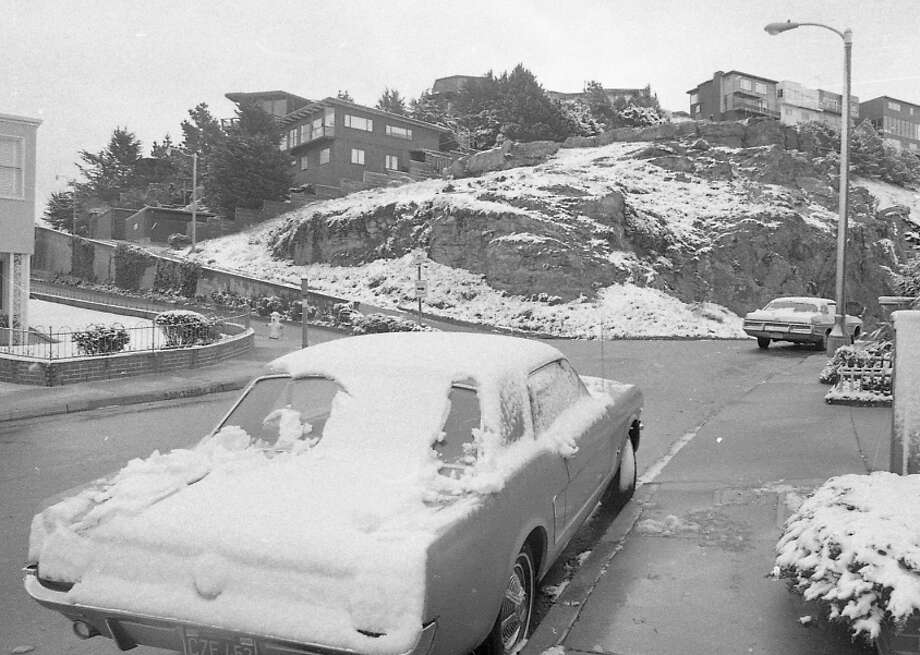 A wider shot of that same Golden Gate Heights location. I'm guessing this Mustang didn't have snow tires at the ready. In the Chronicle photos, there weren't many cars on the road. Feb. 5 was a Thursday and it looked like a lot of people took the day off. Photo: Clem Albers, The Chronicle / ONLINE_YES