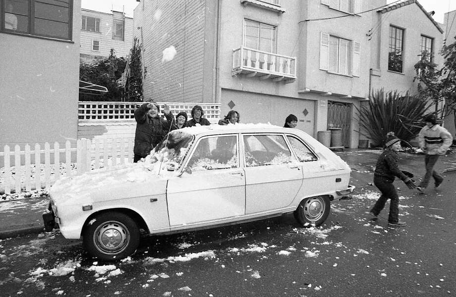 Children use an auto as a shield during a snowball fight in San Francisco. As you'll see in the next slide, these kids were greatly outnumbered, like the Spartans of Thermopylae. Our snowballs will blot out the sun! Then we will fight in the shade! Photo: Clem Albers, The Chronicle / ONLINE_YES