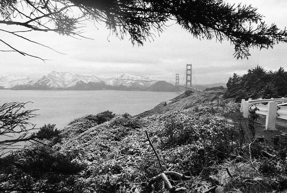 The Golden Gate Bridge as photographed from the Palace of the Legion of Honor on Feb. 5, 1976. Note the Golden Gate National Recreation Area and Mt. Tamalpais are absolutely covered. We have some good Marin snow photo for a future gallery. Photo: Clem Albers, The Chronicle / ONLINE_YES