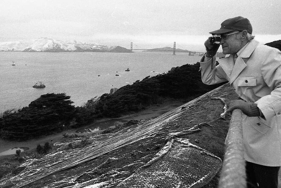 A man takes a photo near Land's End with a view of Golden Gate Bridge in the background. Not 100 percent sure I have the location right but I hope he's capturing the snow-covered ruins of Sutro Baths. Note to self: Trenchcoats never go out of style. This man looks excellent in 1976, 2012 and no doubt in 2048 as well. Photo: Clem Albers, The Chronicle / ONLINE_YES