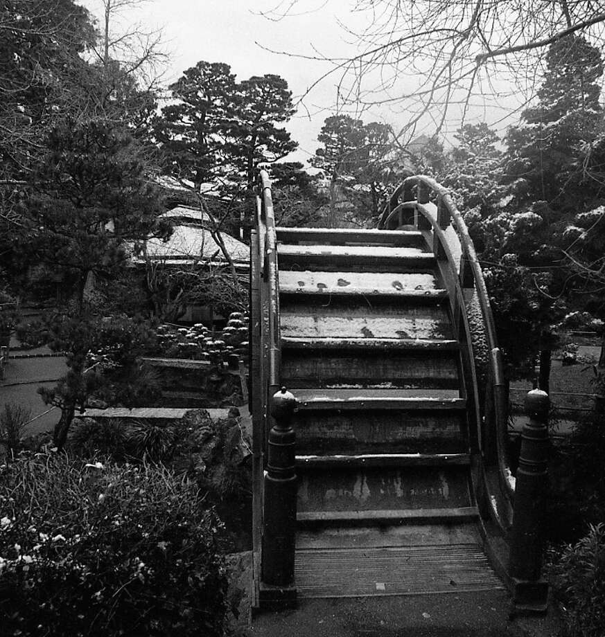 Snow at the Japanese Tea Garden in Golden Gate Park. You can see snow on the trees, and roof of the tea house in the distance. Photo: Clem Albers, The Chronicle / ONLINE_YES