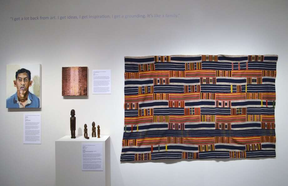 Installation view. Portrait by John Sonsini at left (owed by Ian Berry.) Painting by Ken Kelly at center (owned by John Weber.) Textile by Ewe people of Africa and carved Bataba figures by Lobi people of Africa, both owned by Lisa Aronson (Associate Professor of Art History.) (Courtesy Skidmore College)