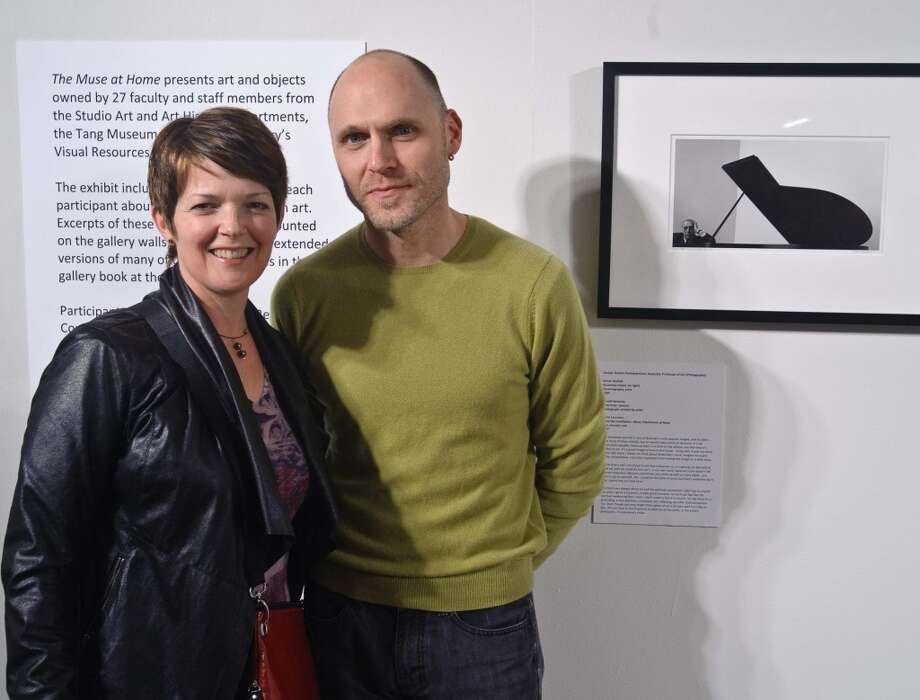 Opening reception shot of Shana and Robert ParkeHarrison with a photograph of Igor Stravinsky by Arnold Newman. (Courtesy Skidmore College)